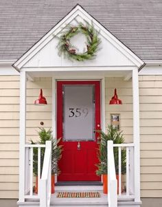 You may ask is a red front door too much? A red front door makes a design statement about what the guest is about to see inside. Small Front Porches, Farmhouse Front Porches, Front Porch Design, Veranda Design, Front Door Makeover, Decoration Christmas, Christmas Porch, Christmas Lights, Merry Christmas