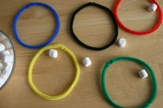 Olympic Ring Toss Craft. Olympic ring toss with mini marshmallows. Now this is a game with a fun ending - eating marshmallows!