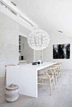 danish interior design white kitchen with white flower chandelier