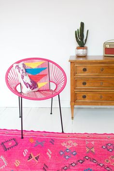Pink Acapulco armchair and fabulous pink rug!