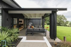 Totara House located in Pukekohe, Auckland, New Zealand. Vertical cedar cladding stained black contrasting against stack bonded block. Black aluminium joinery with Colorsteel longrun roofing. Auckland Waikato Coromandel