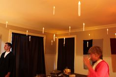 For Harry Potter B-day Party. Fishing line, hot glue, and battery operated candles- done. You can probably find cheap candles after Christmas.