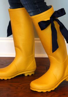 """""""Rain is a good thing"""" when you own a pair of rain boots like these! If you want a different look, the navy ribbon can come off, and you can add a color of your choice. Yellow Rain Boots, Navy Ribbon, Rain Shoes, Blue Suede Shoes, Yellow Black, Summer Outfits, Summer Clothes, Rubber Rain Boots, Fashion Shoes"""