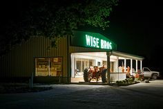 The facade of Wise Bros farm equipment at night along I-70 in Callaway County Missouri by Notley Hawkins Photography. Taken with a Canon EOS 5D Mark III camera with a Canon EF24-105mm f/4L IS USM lens at ƒ/8.0 with a 4 second exposure at ISO 400. Processed with Adobe Lightroom 5.7  and DXO OpticsPro 10.  http://www.notleyhawkins.com/