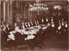 Group portrait of twenty-two men seated around a large dining table at a dinner given by or for Harrison Grey Fiske.