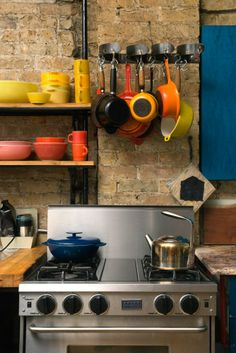 This very clever maker DIYed his own pot hangers with industrial materials. #inspiredkitchen