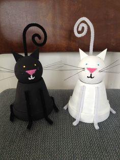 Clay pot cat craft: clay pot, doorknob, paint, pipe cleaners, felt, foam