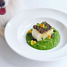 Roasted sesame crusted codfish, baby spinach purée, droplets of chili infused oil