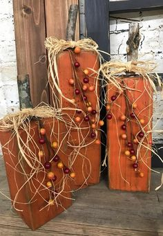 Set of 3 pumpkins made from Douglas Fir post. Set includes 1 pumpkin 7 inches tall, 1 pumpkin 9 inches tall and 1 pumpkin 11 1 2 inches tall. Measurement does not include stem height. Pumpkins are painted with flat exterior paint and distressed with an Fall Wood Crafts, Autumn Crafts, Pumpkin Crafts, Thanksgiving Crafts, Thanksgiving Decorations, Holiday Crafts, Fall Decorations, Wooden Pumpkins, White Pumpkins