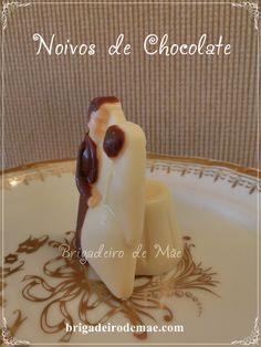Noivos de chocolate, lindos e gostosos...  Enfeitam a mesa e também podem ser oferecidos como lembrança.  Com copinho de chocolate branco, ao leite ou meio amargo, recheado.