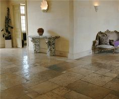 Limestone cannot be trusted in many applications, but it has proven floor worthy.The materials actual ability to hold up throughout the wear, the rustic earthy appearance, or a combination of the two keep limestone open as a possible option in flooring. Limestone Flooring, Natural Stone Flooring, Travertine, Tuscan House, Natural Stones, Tile Floor, Hardwood Floors, Antiques, Tuscany Italy