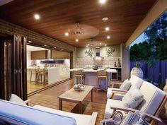 Indoor-outdoor outdoor living design with deck & decorative lighting using brick - Outdoor Living Photo 962097