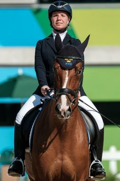Sweden's Anita Johnsson competes in the dressage team test (grade 1a) during the Paralympic Games at the Olympic Equestrian Centre in Rio de Janeiro on September 12, 2016. / AFP / YASUYOSHI CHIBA