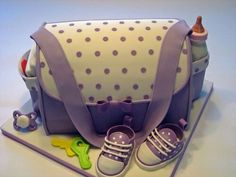 23 Scrumptious Diaper Bag Cakes for Baby Showers Want to give a fantastic present at a baby shower, or maybe you want your guests to enjoy something really special. Diaper bag cakes are the solution…. Gorgeous Cakes, Pretty Cakes, Cute Cakes, Amazing Cakes, Yummy Cakes, Diaper Bag Cake, Baby Diaper Bags, Unique Cakes, Creative Cakes