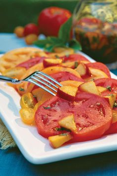 Sliced Tomatoes With Fresh Peach-Basil Vinaigrette - 68 Quick and Delicious Summer Salads - Southernliving. Recipe:Fresh Peach-Basil Vinaigrette  It's a simple but unexpected combination of flavors – and absolutely delicious. You'll taste how special it is with the very first bite.