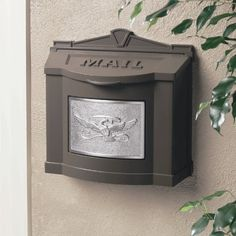 Gaines Wm WallMount Mailbox, Eagle Design Wm8, Bronze/Satin Nickel by Gaines. $189.00. Mounting hardware is included with installation instructions and a template.. Solid die-cast aircraft grade A360 Aluminum construction - can never rust.. Front plate of the mailbox is Satin Nickel finish Aluminum, Polished Brass, Antique Bronzed Brass, or Powder-Coat Aluminum.. Mailbox lid will stay in the upright position and close softly on pades for quiet operation.. Finished with...