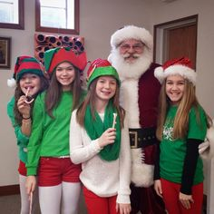 """Posted to Instagram by @visitmorganco. """"Santa and his elves say thank you to everyone who came out to the Cookie Stroll and Winter Market in downtown Martinsville!"""" Photo taken at the Art Sanctuary of Indiana in downtown Martinsville, Indiana."""