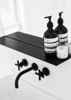 bathroom simple lines black and white interior design styling taps