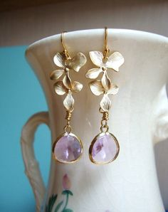 earrings from etsy Cascading Gold Orchid and Lavender Glass Dangle Earrings.)