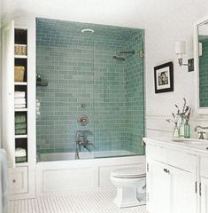 vintage vibe the master bathrooms basketweave tile floor pale blue subway tiled shower