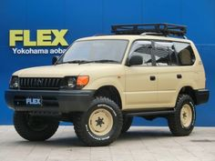 ランクル95プラド TX-LTD 2700G NEWマッドベージュオールペイント&丸目ヘッドライト換装 2インチUP DEAN&BFG255MT  トヨタランドクルーザープラド90TX-LTD 中古車 |FLEX