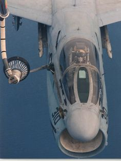 titanium-rain:  A-7E Corsair II aircraft assigned to Light Attack Squadron 46 (VA-46) which is on board the USS John F. Kennedy (CV-67) refuels from an Air Foce KC-135 Stratotanker aircraft while on a training flight during the cease-fire between coalition and Iraqi forces following Operation Desert Storm. 3/14/1991 (U.S. Navy photo)