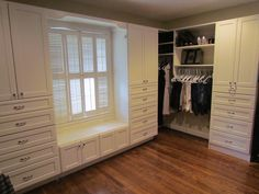 A luxury to be able to turn a bedroom into a closet, we worked around the window to create a bench seat with lots of drawers and space for everything.