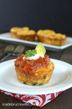 Taco Egg Muffin Cups - scrambled eggs mixed with black beans, tomato, pepper, onion, and cheese.  bake (says 25 min) until egg cooked in the muffin tin.  let cool for 1-2 minutes when you remove from oven.  use knife to go around edges of muffin tin to loosen them.  cool on wire rack.  serve with salsa, sour cream and avocado.