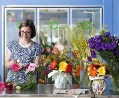 Owner and floral designer Jess McEwen working away and cracking up in this shot by Lindsay Lauckner.