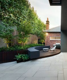 Great way to treat a narrow backyard. Excellent for small company barbeques. You can use different materials on the sitting wall also. Nice use of this space.