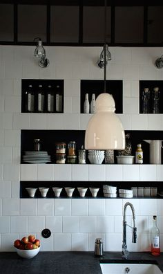 white tile backsplash + recessed storage + lighting in kitchen by marianne evennou