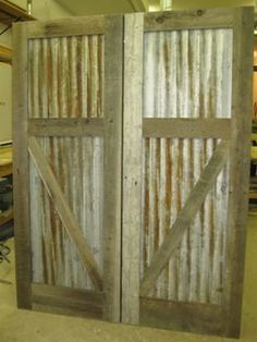 corrugated tin with wood frame doors. think for shed and barn.