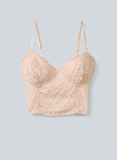 Soft stretch lace lends a lingerie feel to a light pink cropped bustier.