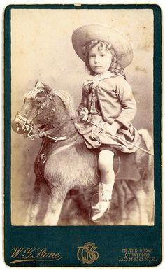 London boy on rocking horse by Mirror Image Gallery, via Flickr