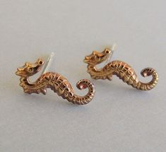 A personal favorite from my Etsy shop https://www.etsy.com/listing/152278903/golden-seahorse-earrings-beach-jewelry