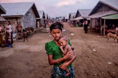 Tomas Munita—The New York Times/Redux Oma Salema, 12, holds her undernourished brother Ayub Khan, 1, at a camp for Rohingya in Sittwe, Burma, on June 5, 2015.