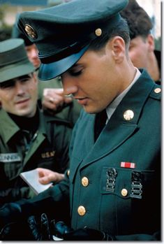 Elvis Presley army uniform - Although he was one of my generation I was never under his spell like most girls.  However time has made me realize that he was a good entertainer and served his country and mankind.  He has remained as large in death as in life--over 40 years now.  You have to admit he was handsome  in this uniform.