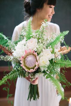 Awesome Bridal Bouquet Composed Of Pink King Protea, White Peonies & Roses, White Wax Flower, Green Sword Fern & Gold Spray Painted Sword Fern~~ Protea Wedding, Fall Wedding Flowers, Floral Wedding, Green Wedding, Bouquet Wedding, Wedding Shoot, Bouquet En Cascade, Protea Bouquet, Protea Flower