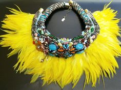 Nyala feather collar by Anita Quansah London. Featuring intricate beadwork with vibrant coloured feathers.