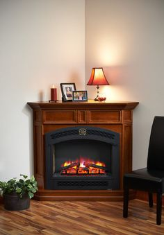 The Columbia Corner Cabinet electric fireplace is a made in the USA product and manufactured from reclaimed Alder wood and stained in a cherry finish. This elec
