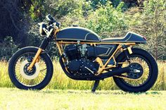 Honda CB750 cafe racer. I'm not really into the gold, but the clean lines are inspiring.