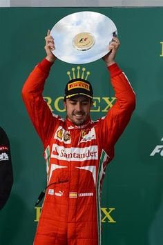 Fernando Alonso (ESP) Ferrari celebrates on the podium.  Formula One World Championship, Rd1, Australian Grand Prix, Race, Albert Park, Melbourne, Australia, Sunday, 17 March 2013