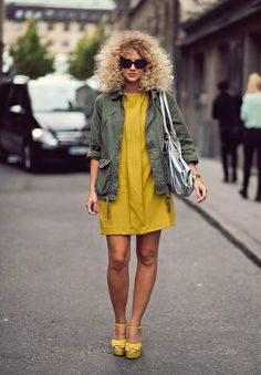 Love the combination of the mustard dress, the olive green jacket and the wild hair! Just adorable!