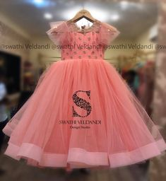 Stunning blush pink color kids gown with net layers. Kids knee length dress with puff net sleeves and hand embroidery stone work on yoke. Girls Frock Design, Kids Frocks Design, Baby Frocks Designs, Baby Dress Design, Kids Gown Design, Kids Lehanga Design, Long Frocks For Kids, Frocks For Girls, Frock Patterns