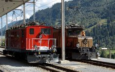 "Former FO HGe no. 36 of 1948 at Disentis/Mustér after working Desperate Railtours ""Great Krokodil Hunt and Swiss Sulzer Explorer"" passes RhB 414 which will work the tour forwards back to Chur Swiss Railways, Locomotive, Paths, Crocodiles, Locs"
