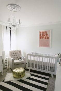 Mint and pink nursery with a crystal chandelier and moroccan pouf #Home