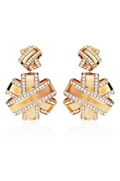 "Haute Vault's bow shaped 18K rose gold drop earrings are a gift for your ears! Accented with diamonds, these are the ultimate glamour girl accessory. Pair with a rose gold and diamond cocktail ring for a night out on the town! Measures 1 1/2"" long and 1"" wide"