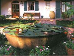 Cast Iron Sugar Kettle used for water feature in Southern garden (image via Bevolo Gas & Electric Lights)