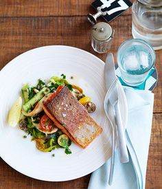 Australian Gourmet Traveller recipe for ocean trout with calamari, cherry tomato and zucchini flower salad by Manta restaurant in Sydney.