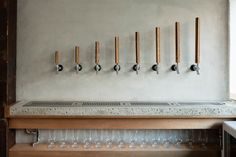 before9 is a minimal sake beer bar located in Kyoto, Japan, designed by PUDDLE